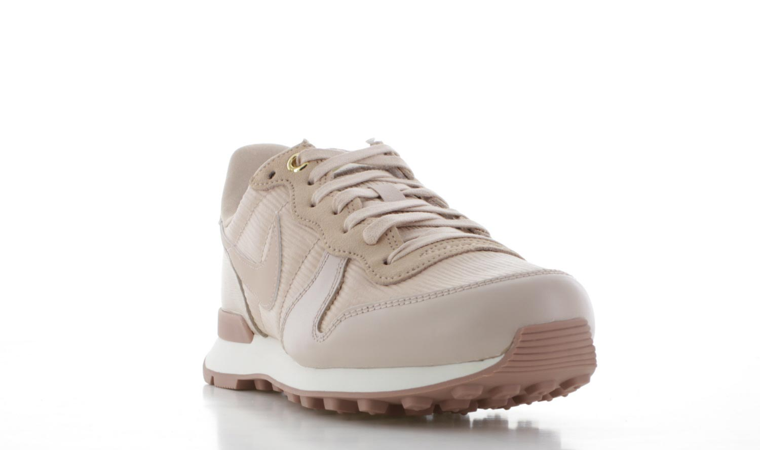 beige nike sneakers internationalist dames